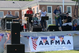 The Bittersweet Band perform live during the Independence Day celebration on Lejeune Field July 4, 2014.