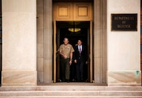 Assistant Commandant of the Marine Corps Gen. John M. Paxton, Jr. and Japanese Minister of Defense Itsunori Onodera exit the Pentagon July 10, 2014. Onodera met with Paxton to discuss the importance of the relationship between the Marine Corps and the Japan Ground Self-Defense Force.