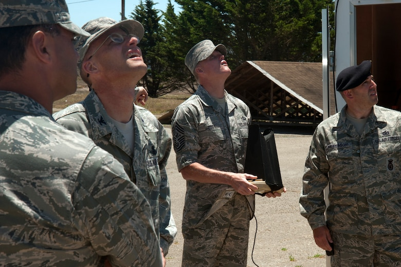 Chief Master Sgt. of the Air Force, James A. Cody, and 30th Mission Support Group leaders, look to the sky to watch a demonstration flight of the Raven-B Digital Data Link, July 8, 2014, Vandenberg Air Force Base, Calif. The Raven-B/DDL is an unmanned aerial vehicle operated by the 30th Security Forces Squadron and Vandenberg is the only stateside base with a Raven mission. (U.S. Air Force photo by Michael Peterson/Released)