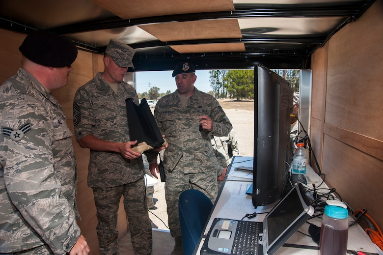 Chief Master Sgt. of the Air Force, James A. Cody, watches a demonstration flight of the Raven-B Digital Data Link, July 8, 2014, Vandenberg Air Force Base, Calif. The Raven-B/DDL is an unmanned aerial vehicle operated by the 30th Security Forces Squadron and Vandenberg is the only stateside base with a Raven mission. (U.S. Air Force photo by Michael Peterson/Released)
