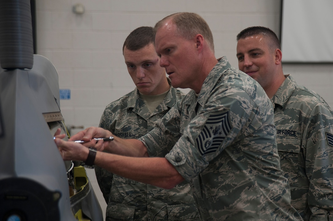 Chief Master Sgt. of the Air Force, James A. Cody, performs simulated missile maintenance under the supervision of 532nd Training Squadron instructors, July 8, 2014, Vandenberg Air Force Base, Calif. (U.S. Air Force photo by Michael Peterson/Released)
