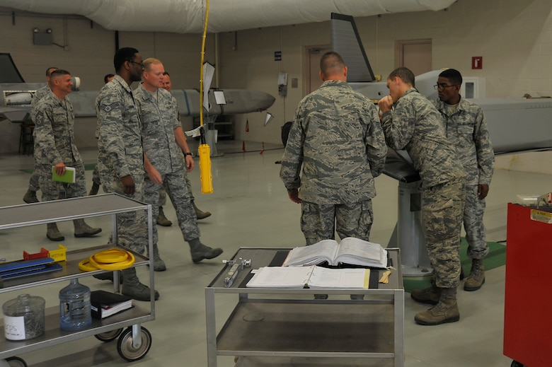 Chief Master Sgt. of the Air Force, James A. Cody, watches hands-on missile maintenance training during his visit with the 532nd training Squadron, July 8, 2014, Vandenberg Air Force Base, Calif. (U.S. Air Force photo by Michael Peterson/Released)