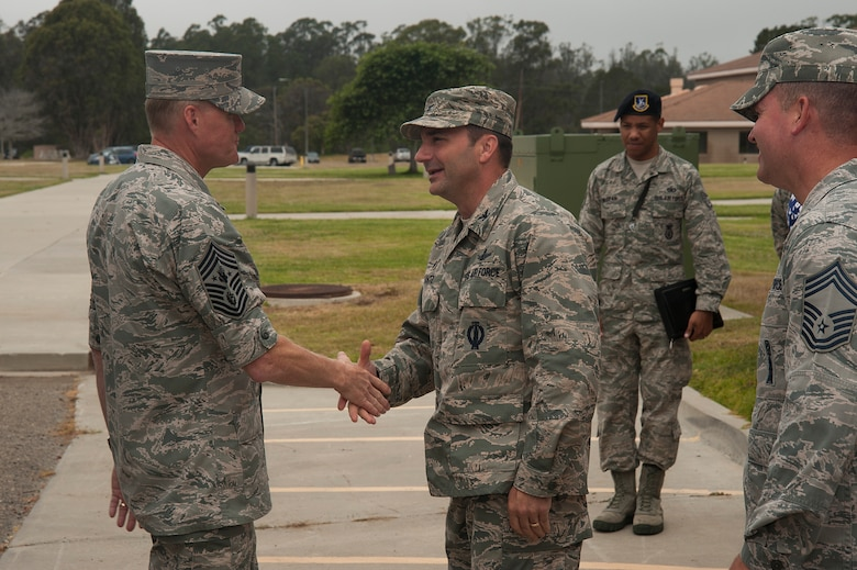 Col Max Lantz, 381st Training Group commander, greets Chief Master Sgt. of the Air Force, James A. Cody, prior to his tour of the 381st TRG campus, July 8, 2014, Vandenberg Air Force Base, Calif. During his visit with the 381st TRG, Cody had the opportunity to interact with enlisted students currently in training as space operators and missile maintainers. (U.S. Air Force photo by Michael Peterson/Released)