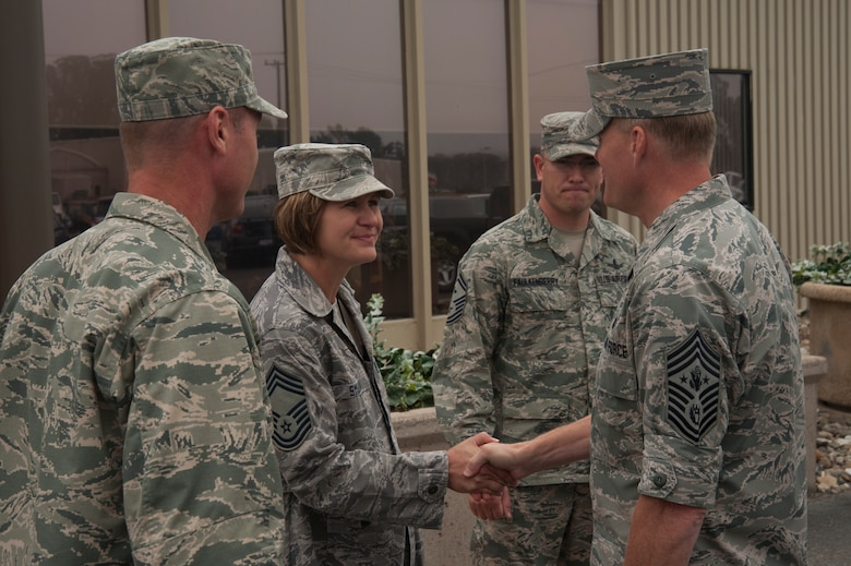 Col. John Giles, 614 Air and Space Operations Center commander, Chief Master Sgt. April Smurda, 614th AOC superintendent, and Senior Master Sgt. Eric Faulkenberry 14th Air Force first sergeant, greet Chief Master Sgt. of the Air Force, James A. Cody, prior to a mission brief and tour July 8, 2014, Vandenberg Air Force Base, Calif. During the tour, Cody met Airmen conducting the Joint Space Operations Center mission and learned about some of the unit's accomplishments. (U.S. Air Force photo by Michael Peterson/Released)