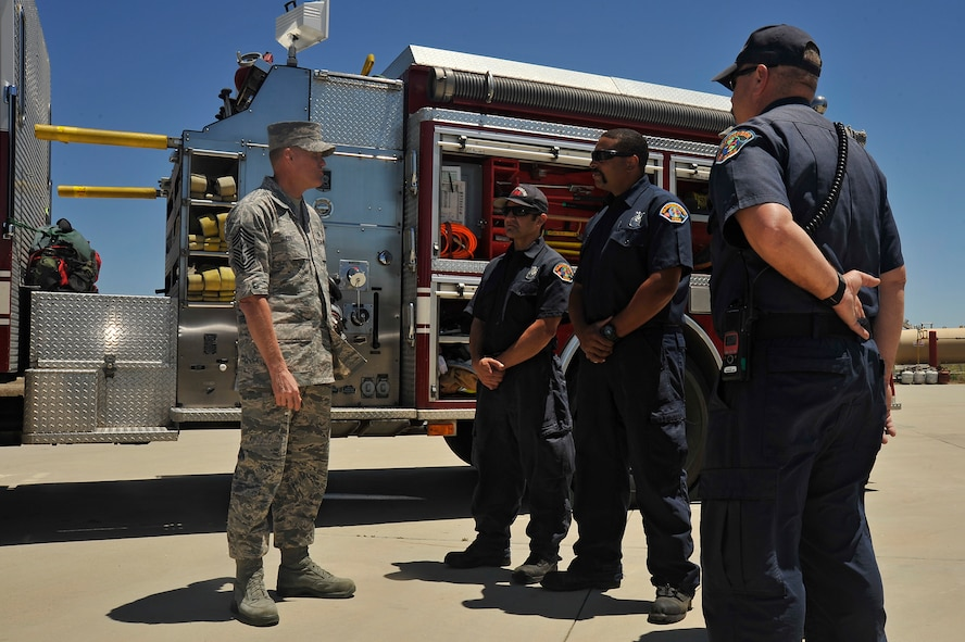 Chief Master Sgt. of the Air Force, James A. Cody, speaks with Vandenberg firefighters during a tour that showcased the 30th Mission Support Group capabilities, July 8, 2014, Vandenberg Air Force Base, Calif. During the tour Cody also had the opportunity to meet the Hot Shots, Vandenberg's team of firefighters, specializing in fighting wildfires. (U.S. Air Force photo by Michael Peterson/Released)