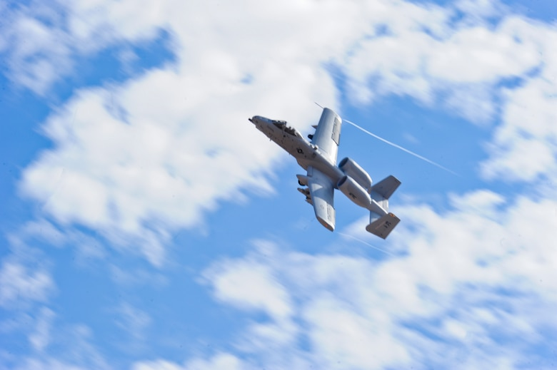 U.S. Air Force A-10 Thunderbolt II flies during the 2014 Hawgsmoke Competition at Barry M. Goldwater Range Two in Tucson, Ariz., July 10, 2014. This year's Hawgsmoke competition focused on forward firing. The participants competed in high, medium, and low-angle strafes. (U.S. Air Force photo by Airman 1st Class Sivan Veazie/Released)