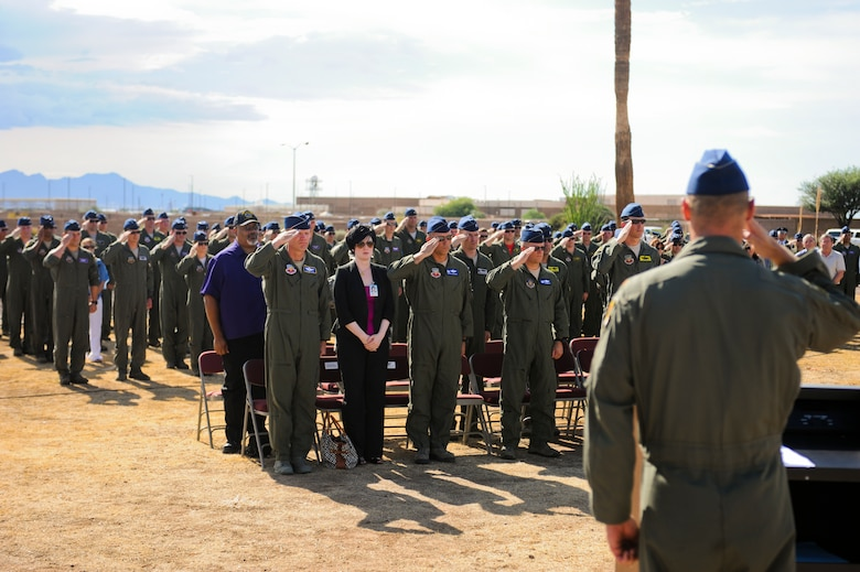 U.S. Air Force Airmen present arms in honor of fallen A-10 pilots during the opening ceremony of the 2014 Hawgsmoke Competition at Davis-Monthan Air Force Base, Ariz., July 9, 2014.  In remembrance of the fallen pilots, the participants of the 2014 Hawgsmoke Competition also held a moment of silence, took a traditional shot of whiskey and smashed the shot glass. (U.S. Air Force photo by Airman 1st Class Sivan Veazie/Released)