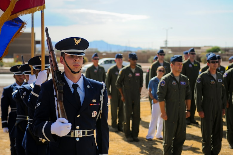 U.S. Air Force Honor Guardsmen prepare to present the colors during the opening ceremony of the 2014 Hawgsmoke Competition at Davis-Monthan Air Force Base, Ariz., July 9, 2014. Hawgsmoke is a biennial U.S. Air Force bombing, missile, and tactical gunnery competition for A-10 Thunderbolt II units. (U.S. Air Force photo by Airman 1st Class Sivan Veazie/Released)