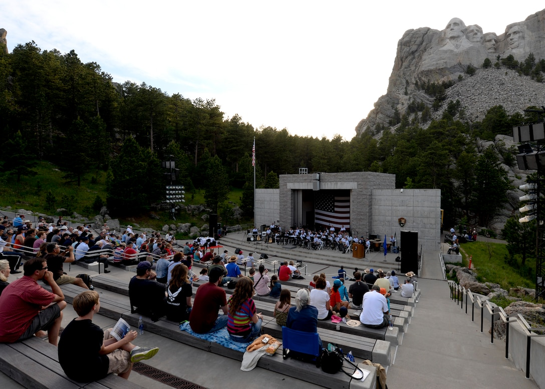 Visitors from around the world attend an Independence Day event at Mount Rushmore National Memorial in South Dakota, July 3, 2014. The event included patriotic themed music played by the U.S. Air Force Academy Concert Band, an enlistment oath ceremony conducted by Col. Kevin Kennedy, 28th Bomb Wing commander, and a flag folding ceremony performed by the Ellsworth Air Force Base Honor Guard. (U.S. Air Force photo by Senior Airman Anania Tekurio/Released)
