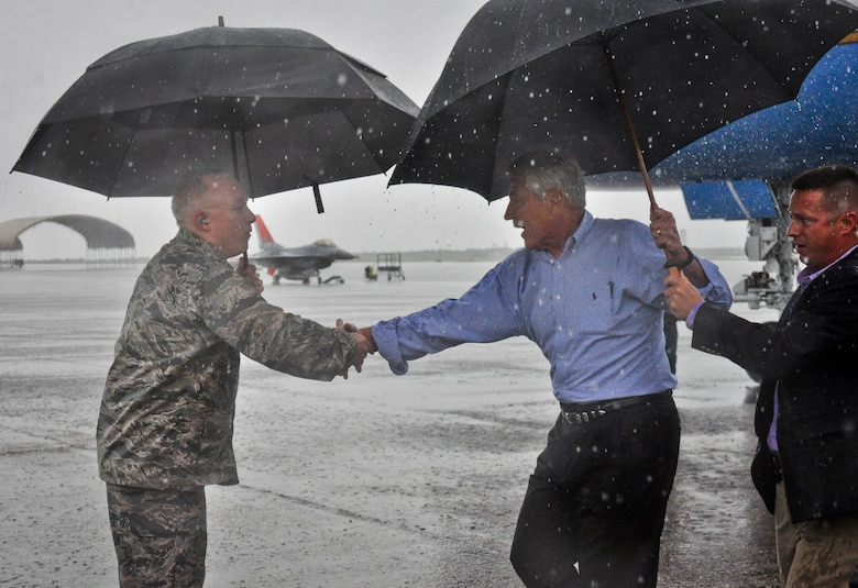 Defense Secretary Chuck Hagel greets Maj. Gen. Scott Jansson, the Armament Directorate program executive officer, upon arriving to Eglin Air Force Base, Fla., July 9.  Hagel visited the base to tour the 33rd Fighter Wing and F-35 Lightning II integrated training center.  He held a 45-minute troop call to praise the work of the service members who began and continue to improve the DOD's newest fighter program.  (U.S. Air Force photo/Ilka Cole)