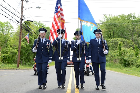 The 103rd Airlift Wing's Base Honor Guard marches in the Memorial Day parade, East Granby, Conn., May 26, 2014.  (U.S. Air National Guard photo by Senior Airman Emmanuel Santiago)