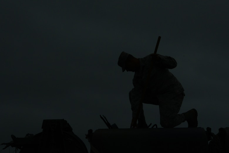 Airman 1st Class Erin Cruz, an aerospace ground equipment technician from the 103rd Air Control Squadron, checks fuel levels from the top of one of the unit's trucks shortly after sunset during a deployed training exercise at the National Guard Training Center, Sea Girt, N.J., June 10.  Airmen maintained 24-hour satellite connectivity in field conditions with the help of tactical generators and the trucks that fueled them continuously during the deployment.  (U.S. Air National Guard photo by Senior Airman Emmanuel Santiago)