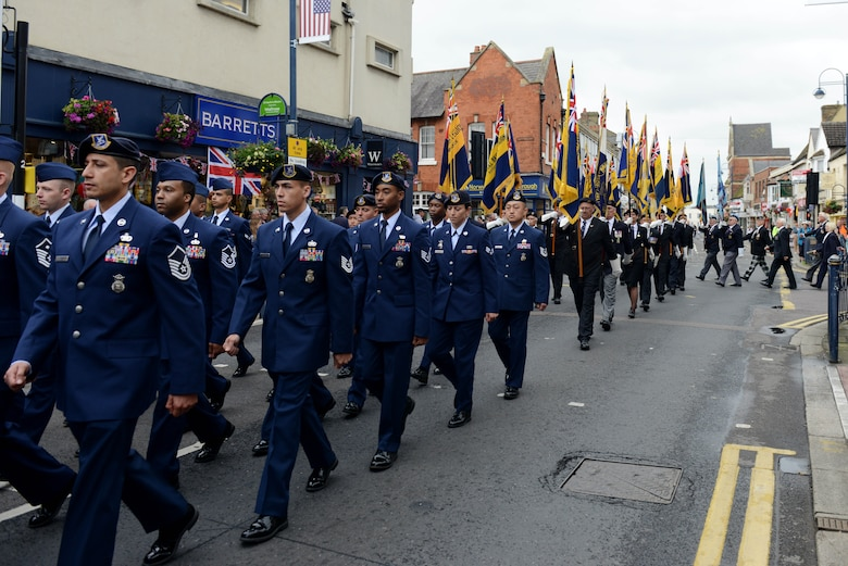 Airmen from the 423rd Air Base Group march through the streets of St. Neots, United Kingdom, during the Freedom of the Town and Armed Forces Day celebration, July 5, 2014. The festival honored past and present Service members from the United States and United Kingdom. (U.S. Air Force photo by Tech. Sgt. Chrissy Best/Released)