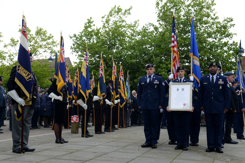 Airmen from the 423rd Air Base Group prepare to march through the streets of St. Neots, United Kingdom, during the Freedom of the Town and Armed Forces Day celebration, July 5, 2014. The festival marked the first time St. Neots presented the freedom of the town scroll to an entire U.S. military unit. (U.S. Air Force photo by Tech. Sgt. Chrissy Best/Released)