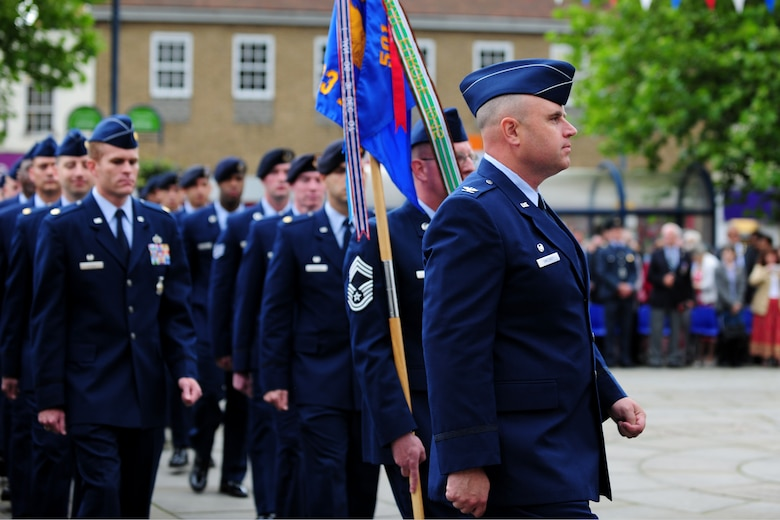 U.S. Air Force Col. Steven Sweeney, 423rd Air Base Group commander, leads a flight of Airmen during the Freedom of the Town and Armed Forces Day at St. Neots, United Kingdom, July 5, 2014. The festival marked the first time the city presented the freedom of the town scroll to American Armed Forces. (U.S. Air Force photo by Staff Sgt. Jarad A. Denton/Released)