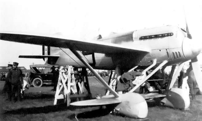 The Navy-Wright NW-1 (A-6543) with race number 9 at Selfridge Field for the 1922 Pulitzer Race. Note that the engine cowling covers the engine cylinder banks. The image illustrates the limited ground clearance of the wheel fairings. (U.S. Navy photo)