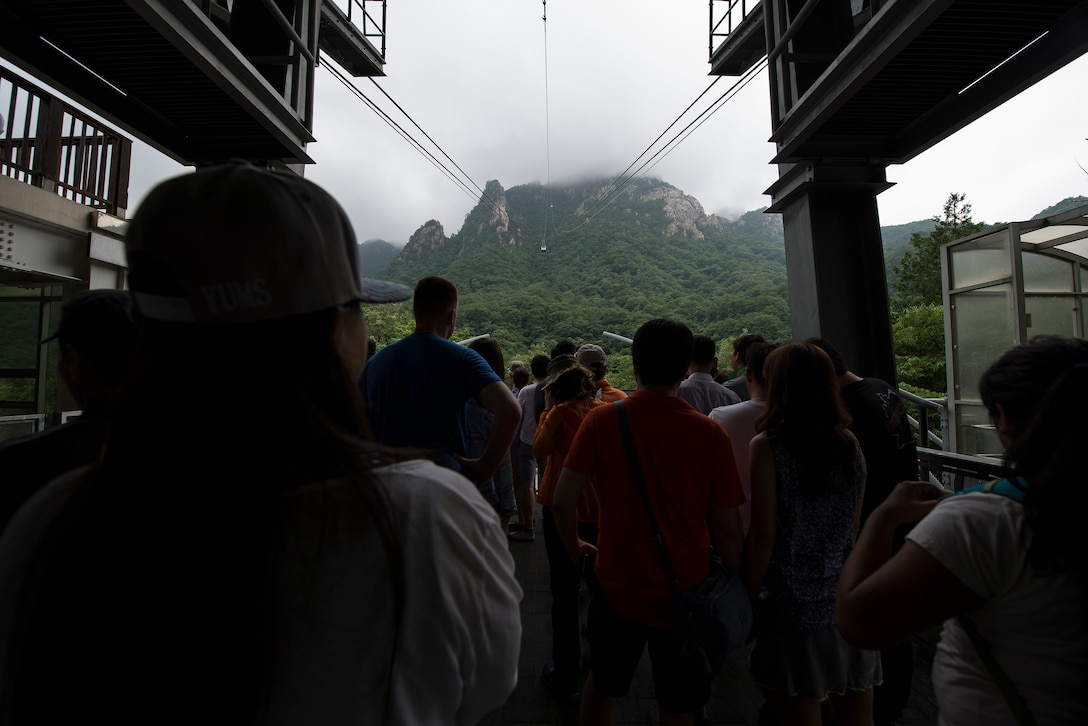 People wait for the cable car lift in Seoraksan Nationa Park July 5, 2014, in Sokcho, Republic of Korea. The cable car costs W9,000 per person and runs directly to one of the mountain range's peaks. (U.S. Air Force photo by Staff Sgt. Jake Barreiro)