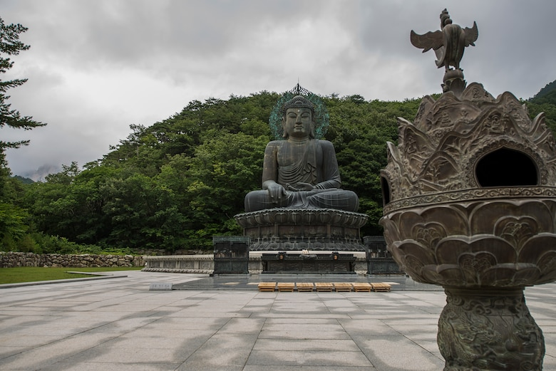 The Great Unification Buddha belongs to the Sinhuengsa Temple in Seoraksan National Park, pictured here July 5, 2014, in Sokcho, Republic of Korea. The statue and its pedestal are made of bronze and worth more than $4 million. (U.S. Air Force photo by Staff Sgt. Jake Barreiro)