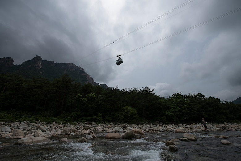 A cable car ascends to one of the mountain peaks in Seoraksan National Park July 5, 2014, in Sokcho, Republic of Korea. The cable car allows travelers to circumvent hiking one of the park's numerous trails, some of which are as long as 16 kilometers. (U.S. Air Force photo by Staff Sgt. Jake Barreiro)