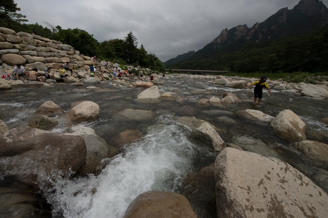 People play in the river in Seoraksan National Park July 5, 2014, in Sokcho, Republic of Korea. Seoraksan National Park is one of the major forest and ecological preserves in South Korea. (U.S. Air Force photo by Staff Sgt. Jake Barreiro)