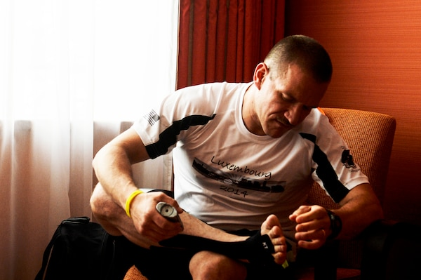 Air Force Master Sgt. Donald Stichter prepares his feet prior to the start of the ING Luxembourg Night Marathon, May 31, 2014. Stichter trained for more than five months to get ready for the race. U.S. Air Force photo by Senior Airman Rusty Frank