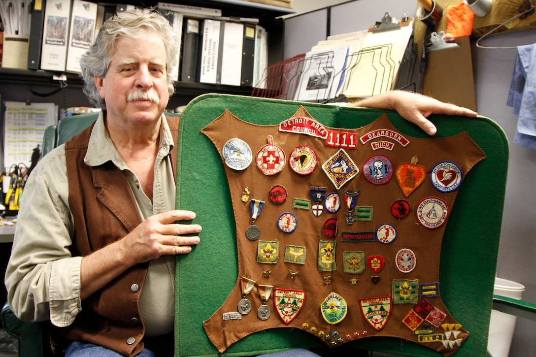 The Charleston District has nine Eagle Scouts in our approximately 250 employees. Each of these Eagle Scouts has a different story about their experience. Here, Paul Hinchcliff shows off his collection of badges and medals he earned while in Scouts.