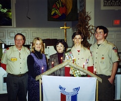 The Charleston District has nine Eagle Scouts in our approximately 250 employees. Each of these Eagle Scouts has a different story about their experience. Here, Chris Mims (second from right) stands with his family at his Eagle ceremony.