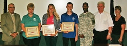 Three garrison employees from the DFMWR are recognized for their efforts in helping a Soldier in distress.