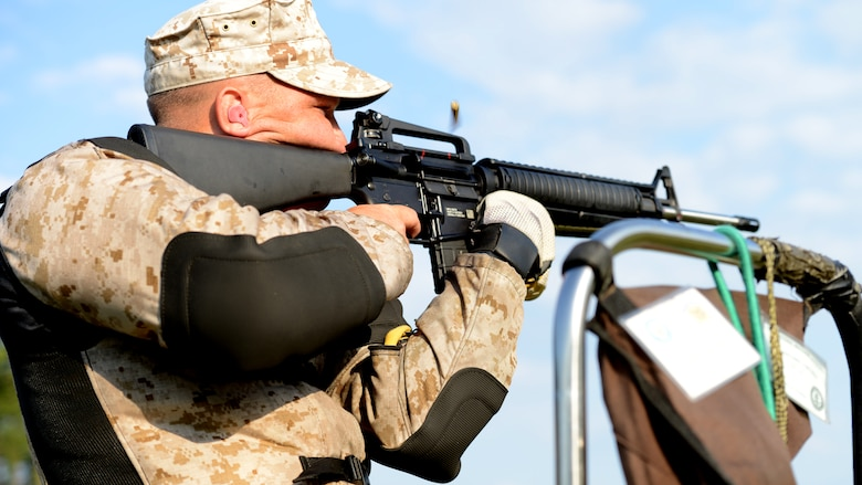 Cpl. Antonio Diconza fires a weighted M-16 rifle at the 53rd Annual Interservice Rifle Championship aboard Marine Corps Base Quantico, Virginia, July 7, 2014. The competitors' rifles are weighted to fit their individual needs, allowing them to keep steady aim and reduce the recoil from heavy bullets. Diconza is an infantry mortarman and competitive shooter with the Marine Corps Rifle Team.