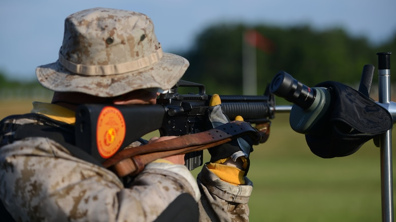 Sgt. Joseph Peterson, a member of the Marine Corps Shooting Team, prepares to fire a round during the 53rd Annual Interservice Rifle Championship on July 7, 2014, at Range 4, Weapons Training Bn., Marine Corps Base Quantico. Peterson was one of several Marines who competed in the individual events and will also shoot in the team events.