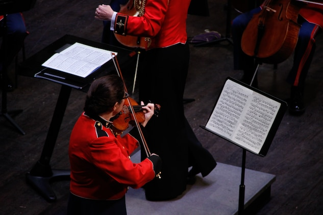 On June 7, 2014, Capt. Michelle A. Rakers conducted the Marine Chamber Orchestra and soloist concertmaster Master Gunnery Sgt. Claudia Chudacoff in concert at the Rachel M. Schlesinger Concert Hall and Arts Center in Alexandria, Va. (U.S. Marine Corps photo released/Staff Sgt. Rachel Ghadiali)