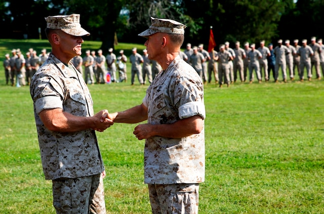 Col. Joseph Shrader (left) and Brig. Gen. Frank Kelley shake hands following the passing of the organizational colors during the Marine Corps Systems Command change of command ceremony July 11 on Hospital Point aboard Marine Corps Base Quantico, Virginia. Kelley, who served as commander since July 2010, relinquished command to Shrader.