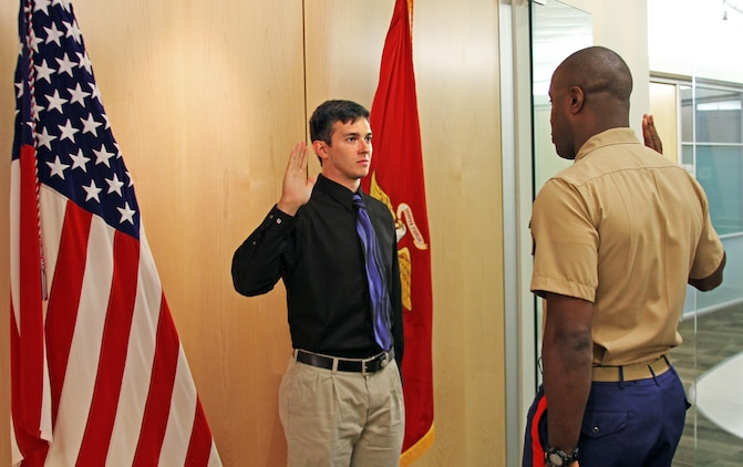 U.S. Marine Corps officer candidate Jamie Gastrich, a native of Richmond, Va., recites the oath of office as administered by U.S. Marine Corps Capt. Devin Claridy, an officer selection officer for Officer Selection Station Norfolk in Norfolk, Va., July 7, 2014. Gastrich, a junior at Old Dominion University, became the first candidate to contract from Recruiting Station Richmond's newest officer selection station. (U.S. Marine Corps photo by Cpl. Aaron Diamant/Released)