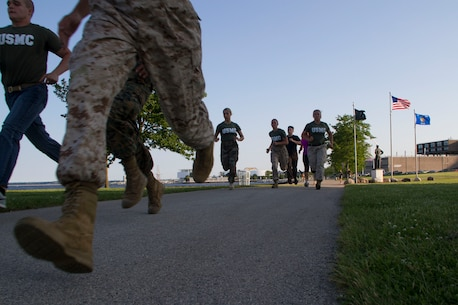 Officer candidates and applicants begin the Combat Fitness Test with an 880-yard sprint at Veterans Park in Milwaukee, Wis., July 10, 2014.  Officer Selection Station Milwaukee conducted a Combat Fitness Test to help prepare their officer candidates and applicants for Officer Candidates School.