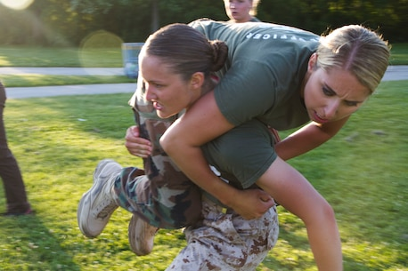 Candidate Lauren Glomski fireman carries simulated casualty, Applicant Brooke Wargolet, during the maneuver under fire portion of the Combat Fitness Test at Veterans Park in Milwaukee, Wis., July 10, 2014.  Officer Selection Station Milwaukee conducted a Combat Fitness Test to help prepare their officer candidates and applicants for Officer Candidates School.
