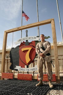 U.S. Marine Sgt. Michael M. Estes, 20, a native of Torrance, Calif., and electro-optical ordnance repairer with Combat Logistics Battalion 7, Regional Command (Southwest), stands outside of the CLB-7 headquarters aboard Camp Leatherneck, Helmand province, Afghanistan, April 9, 2014. Estes deployed during January 2014, and kept Marine Corps individual and heavy weapons optics in the fight during ongoing security operations and led redeployment and retrograde efforts of Marine Corps equipment from the region.