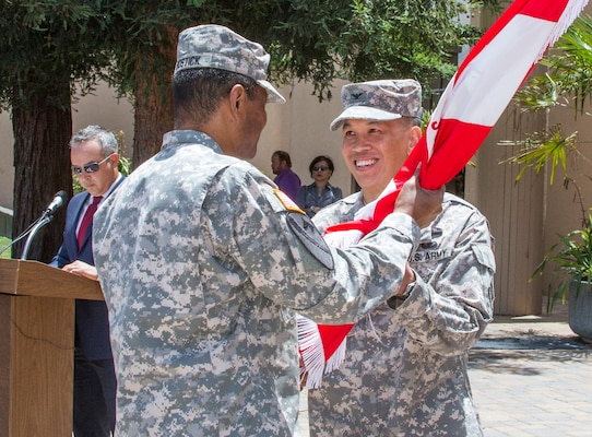 U.S. Army Corps of Engineers Chief, Lt. Gen. Thomas P. Bostick, passes the USACE South Pacific Division flag to Colonel (Promotable) Mark Toy during a ceremony at the Bay Model in Sausalito, Calif., June 30, 2014. COL (P) Toy assumed command from Brig. Gen. C. David Turner. COL (P) Toy spoke about returning to SPD and that taking care of people is our highest priority.