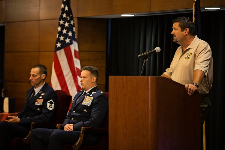 Karl Beilby, a contractor with the Fort Campbell, Ky.-based 101st Airborne Division,  speaks during an award ceremony for Master Sgt. Roger Sparks, a pararescueman from the 212th RQS on Joint Base Elmendorf-Richardson, July 11. Sparks was awarded the Silver Star, the nation's third-highest award for valor, for his role in a firefight with insurgents during Operation Bulldog Bite in Afghanistan's Watapur Valley on Nov. 14, 2010. Beilby was one of four men that Sparks was credited with saving during the events of that day. (U.S. Army National Guard photo by Sgt. Edward Eagerton/released)