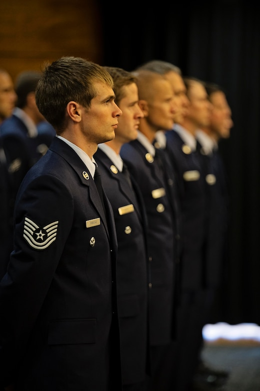 Pararescuemen with the Alaska Air National Guard's 212th Rescue Squadron stand in formation during a Silver Star Medal award ceremony on Joint Base Elmendorf-Richardson, July 11. A fellow 212th pararescueman, Master Sgt. Roger Sparks, was awarded the Silver Star, the nation's third-highest award for valor, for his role in a firefight with insurgents during Operation Bulldog Bite in Afghanistan's Watapur Valley on Nov. 14, 2010. His actions during the combat operation resulted in four American lives being saved and four casualties being returned to their families with honor and dignity. (U.S. Army National Guard photo by Sgt. Edward Eagerton/released)