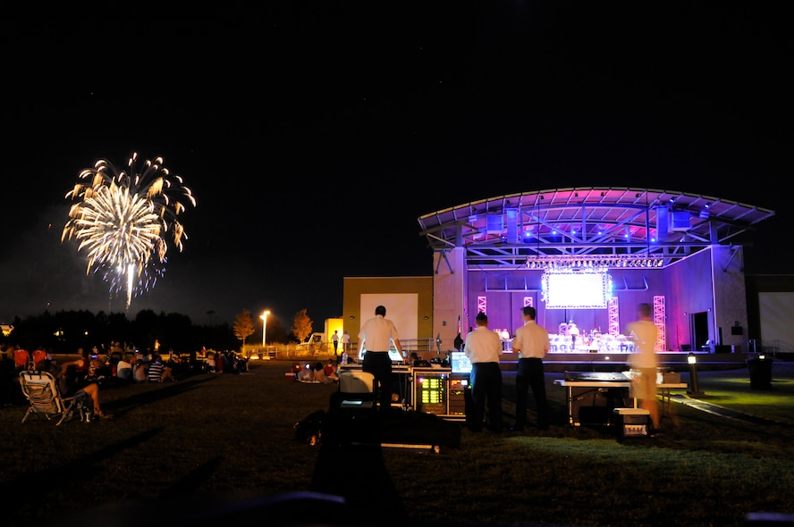 The Air National Guard Band of the South performs along with a fireworks display during the final concert of their Summer Concert Series, July 4, 2014, in Panama City, Fla., at the Aaron Bessant Park Amphitheater. During this years' tour they played in three states, travelled more than 2,100 miles, and entertained an estimated 5,000 people. (U.S. Air National Guard photo by Senior Master Sgt. Paul Mann/Released)