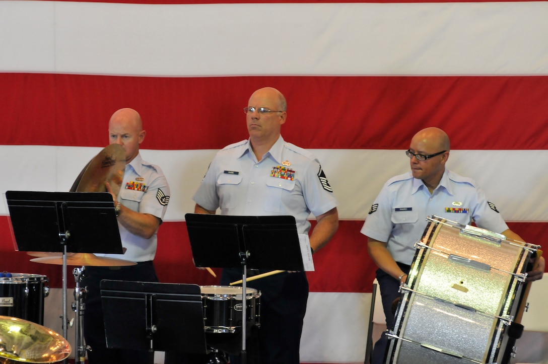 Staff Sgt. Jason Gann, Master Sgt. Eric Odiorne, and Senior Airman Jose Ramirez provide the beat during one of the three concerts performed by the Air National Guard Band of the South onboard the USS Yorktown, anchored in Mt. Pleasant, S.C., July 1, 2014. Covering three states and more than 2,100 miles this year, the band perfected its mission of educating and entertaining military and civilian audiences, performing before more than 5,000 people. U.S. Air National Guard photo by Senior Master Sgt. Paul Mann/Released