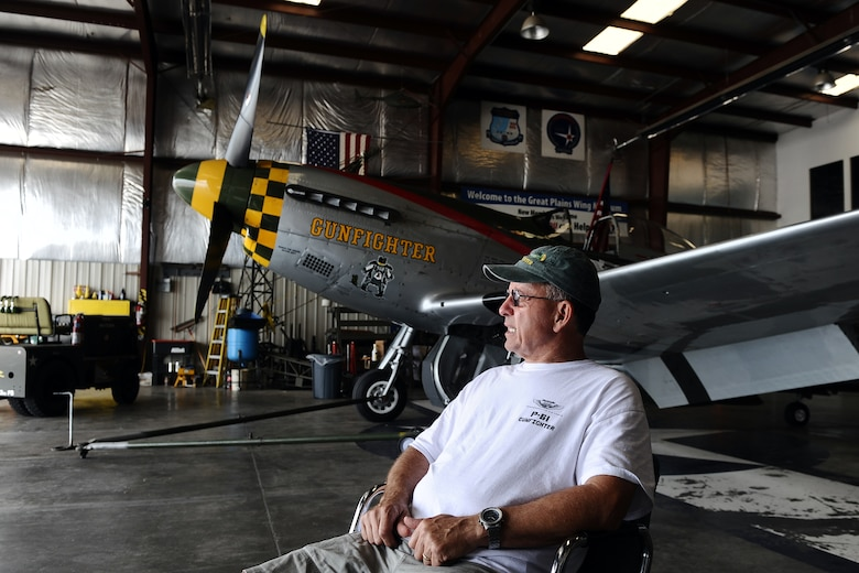 Larry Lumpkin, the current caretaker and pilot of the P-51 Mustang, sits down for an interview about his aviation career inside of the Commemorative Air Force hangar at the Council Bluffs Municipal Airport, Iowa, on June 27. Lumpkin adopted the role of pilot and caretaker of the Mustang from retried Brig. Gen. Regis Urschler, former 55th Strategic Reconnaissance Wing commander.  (U.S. Air Force photo by Josh Plueger/Released)