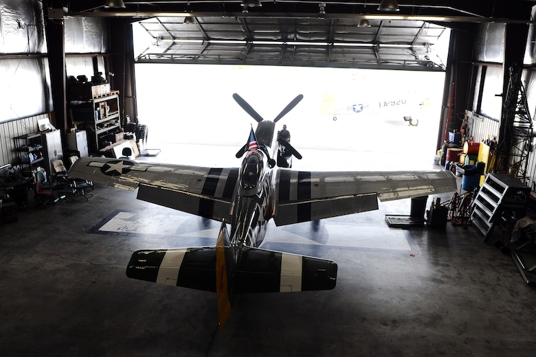 The P-51 Mustang Gunfighter sits inside the Commemorative Air Force hangar at the Council Bluffs Municipal Airport, Iowa, on June 27. The P-51 has been a marquee act at several air shows around the country for decades.  (U.S. Air Force photo by Josh Plueger/Released)