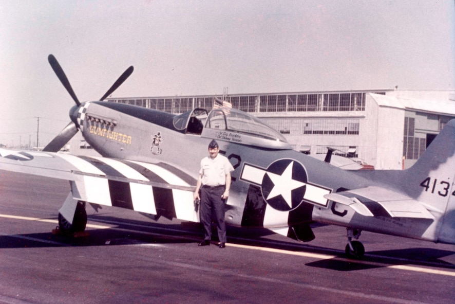 OFFUTT AIR FORCE BASE, Neb. -- Now retired U.S. Air Force Brig. Gen. Regis F.A. Urschler, former 55th Strategic Reconnaissance Wing commander, stands in front of his newly acquired P-51 Mustang in 1978. Urschler had the Mustang repainted in the 343d Fighter Squadron colors, which has evolved into the 343d Reconnaissance Squadron located here. (Courtesy Photo)