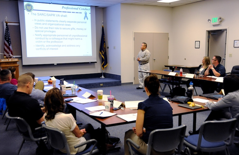 Oregon Army National Guard Maj. Rey Agullana, Sexual Assault Response Coordinator (SARC), for Joint Forces Headquarters, in Salem, Ore., leads a discussion to sexual assault victim advocates during three days of training at the Portland Air National Guard Base, Ore., June 24-26, 2014. (U.S. Air National Guard photo by Tech. Sgt. John Hughel, 142nd Fighter Wing Public Affairs/Released)