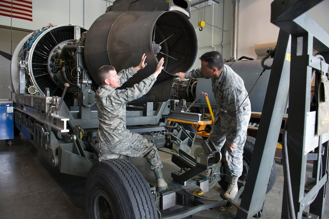 Master Sgt. Matthew Gardenhour, a propulsion specialist, explains parts on a F117 PW100 engine to Lt. Col. Christian Cunningham, deputy commander of the maintenance group, after leading a slide show presentation detailing the parts on the C-17 engine to Cunningham and members of the propulsion element, June 7. (Air National Guard photo by Master Sgt. Emily Beightol-Deyerle)