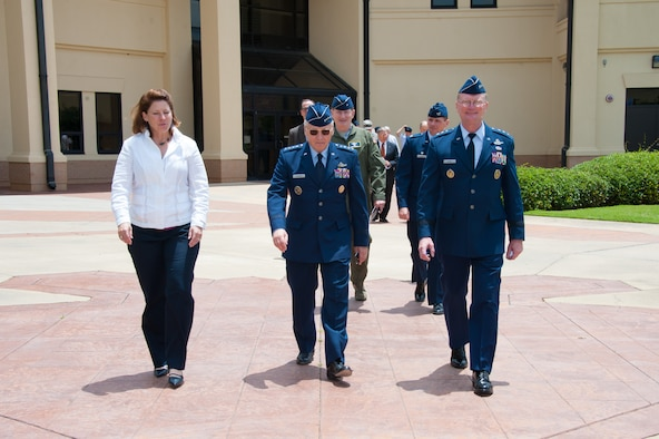 Gen. Bruce Carlson, (ret.) walks out of the Jeanne M. Holm Center For Officer Accessions and Citizen Development Officer Training School campus with Lt. Gen. David Fadok, his wife, and other members of the official party, after a ceremony for Carlson held at Maxwell, June 27, 2014. Carlson was selected to recive the Air Force Reserve Officer Training Corps Distinguished Alumni Award to commemorate his thirty seven years of exepmlary military service. (U.S. Air Force Photo by Staff Sgt. Gregory Brook)