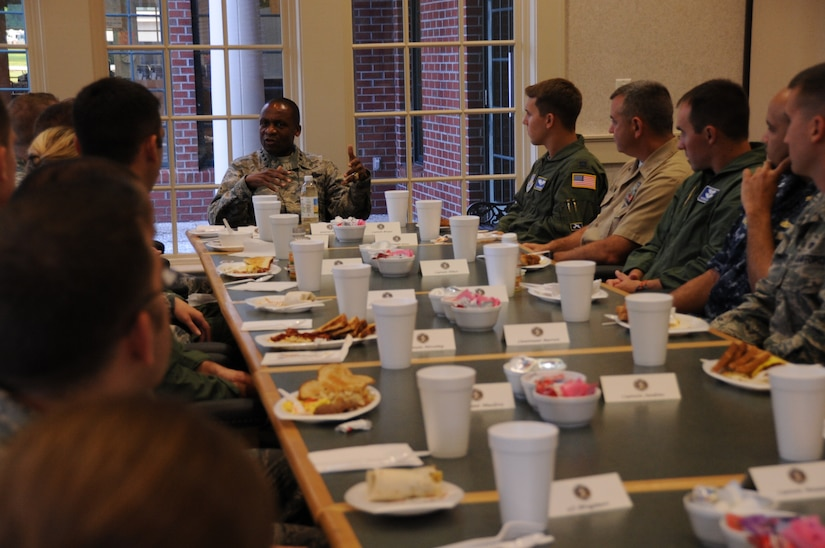 Gen. Darren McDew, Air Mobility Command commander, engages young officers at a breakfast during his visit to Joint Base Charleston July 11, 2014. McDew used this forum to field questions and seek input from JB Charleston's junior servicemembers while sharing leadership lessons from his 32 years on active duty. The AMC commander interacted with service members, families, Department of Defense civilian employees, contractors and local civic leaders in a variety of venues at JB Charleston during his three-day visit. McDew also previously commanded the 14th Airlift Squadron at Charleston Air Force Base from 1997-1999.  (U.S. Air Force photo/1st Lt. Christopher Love)