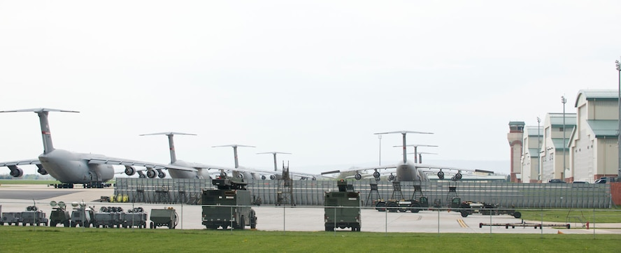 C-5 aircraft line the tarmac, April 25, after missions were cancelled for a safety stand down. Wing leadership called for the stand down after a number of challenges were identified as distractions to safe flying. (Air National Guard photo by Master Sgt. Emily Beightol-Deyerle)