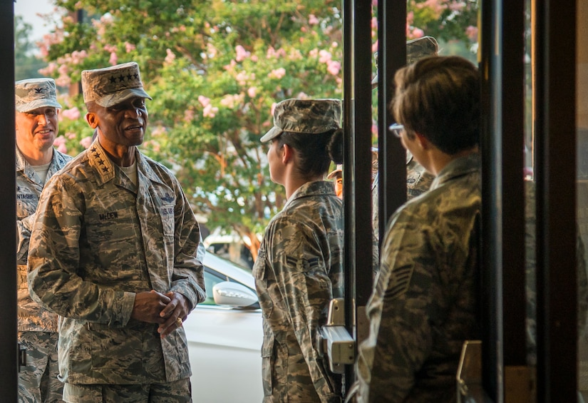 Gen. Darren¬ McDew, Air Mobility Command commander, is greeted by Airmen from the 628th Force Support Squadron as he enters the Gaylor Dining Facility July 10, 2014, at Joint Base Charleston, S.C. During the breakfast, McDew met with 20 junior servicemembers from various branches at JB Charleston to answer questions, solicit feedback and offer words of encouragement. (U.S. Air Force photo/ Airman 1st Class Clayton Cupit)
